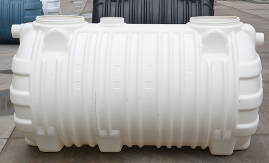 What is the principle of the integrated three-cell septic tank?